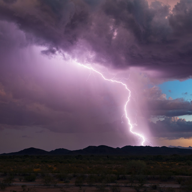 """Lightning bolt strike at sunset"" stock image"