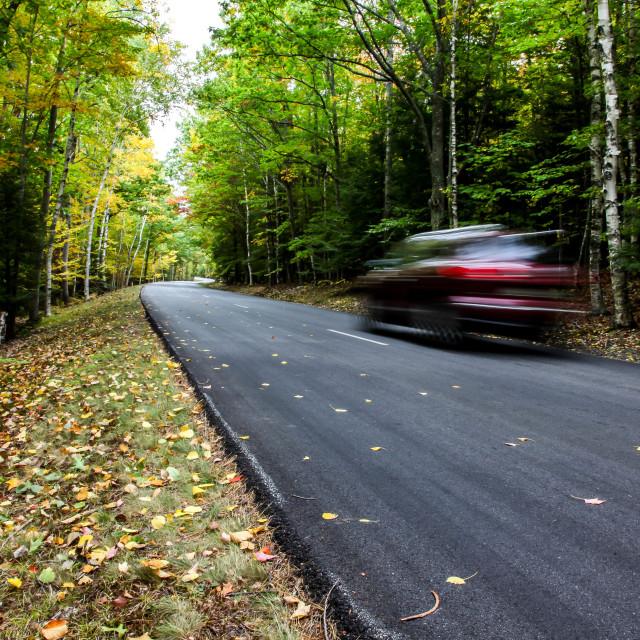 """Car driving thru autumn road"" stock image"