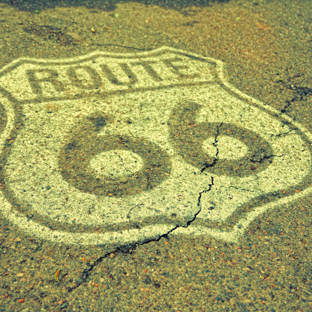 """Old Route 66 sign on the asphalt."" stock image"