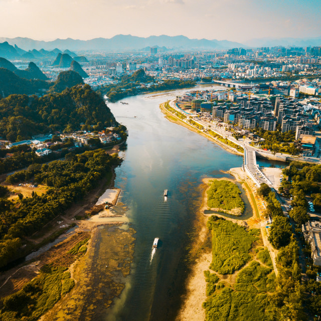"""Aerial photo of a boat sailing down river Li in Guilin China"" stock image"