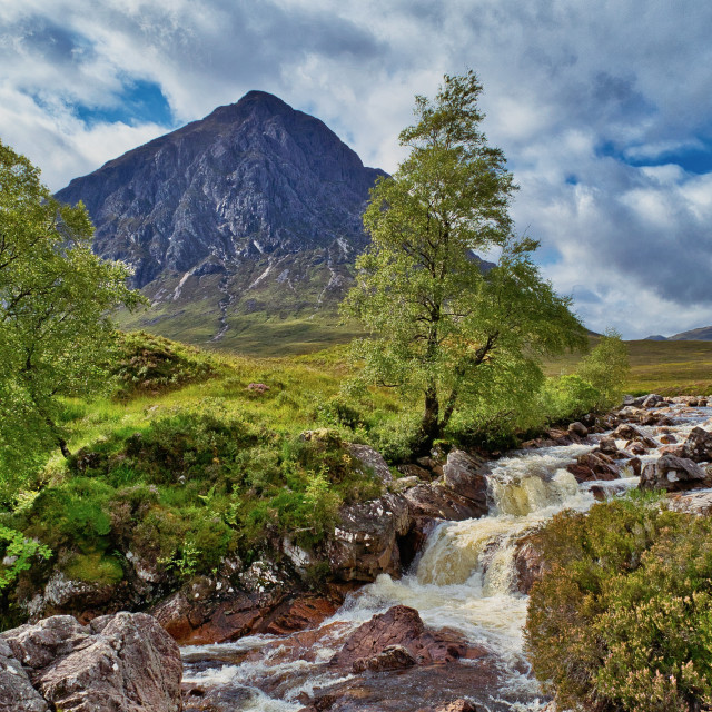 """Waterfall in front of Buachaille Etive Mòr"" stock image"