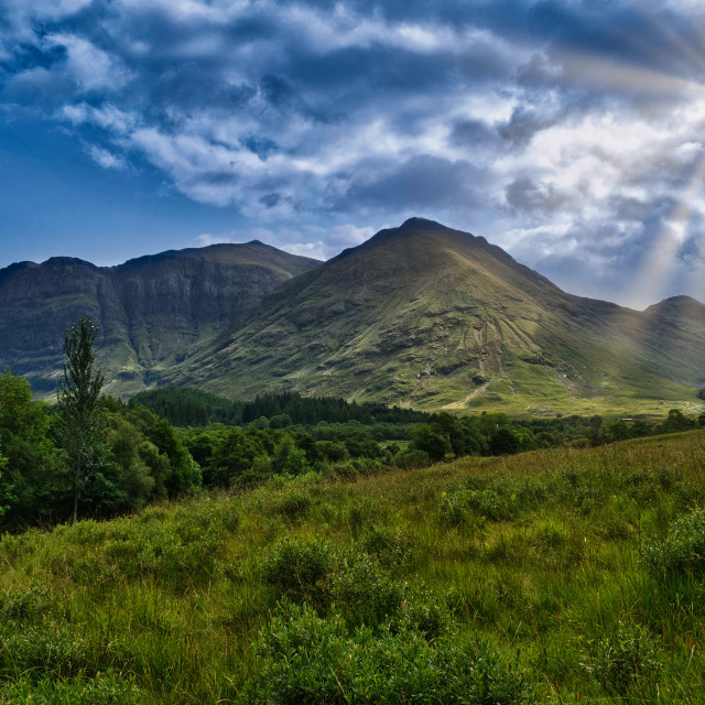 """Rays of sunlight at Glen Coe"" stock image"