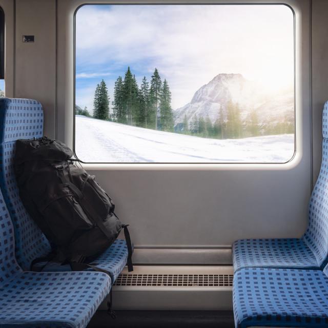 """Train seats and winter scene on the window"" stock image"