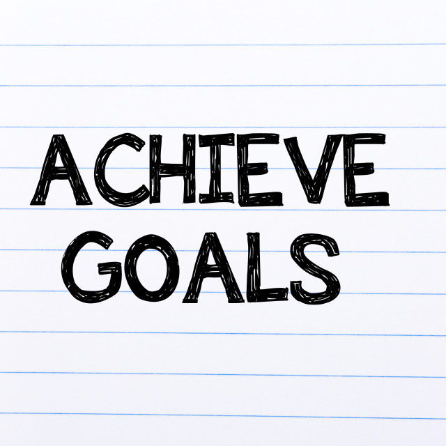 """""""Achieve goals Text written on notebook page"""" stock image"""