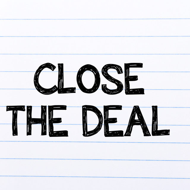 """""""Close the Deal Text written on notebook page"""" stock image"""