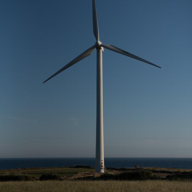 """""""Wind turbine against blue sky"""" stock image"""