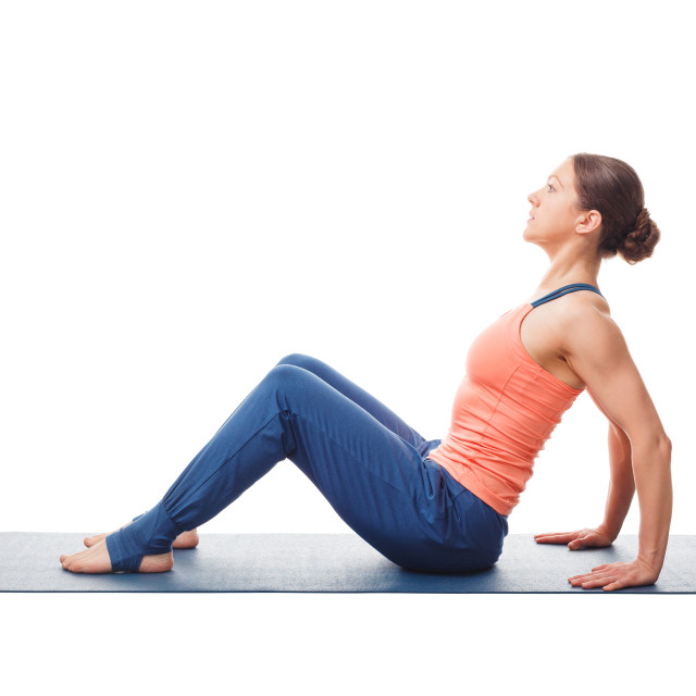 """Woman preparing for yoga asana Upward Plank Pose Purvottanasana"" stock image"