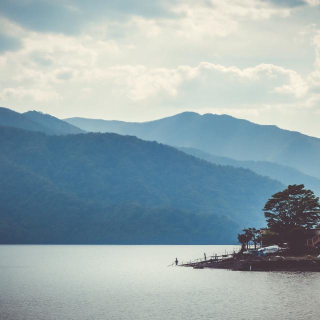"""Fisherman on Chuzenji lake, Nikko, Japan"" stock image"