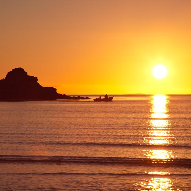 """""""Setting Sun at Calgary Beach"""" stock image"""