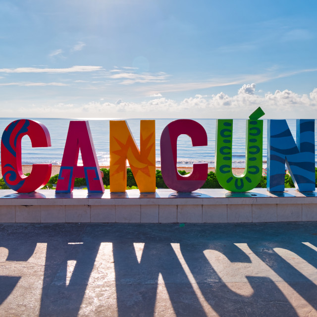 """Cancun sign in front of Playa Delfines in the Caribbean Sea , Cancun,Mexico, in September 7, 2018"" stock image"