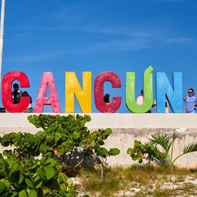 """Tourists in front the sign of Cancun"" stock image"