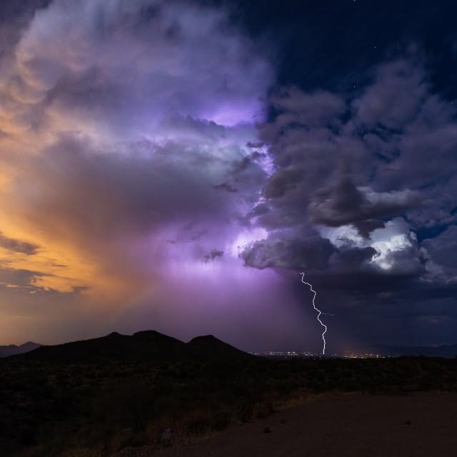 """Thunderstorm cloud illuminated by lightning."" stock image"