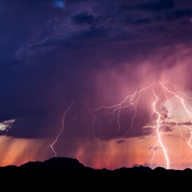 """Dramatic lightning strike and sunset sky."" stock image"