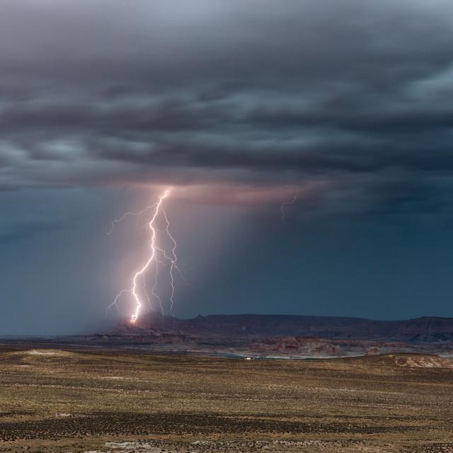"""Lightning bolt striking a cliff."" stock image"