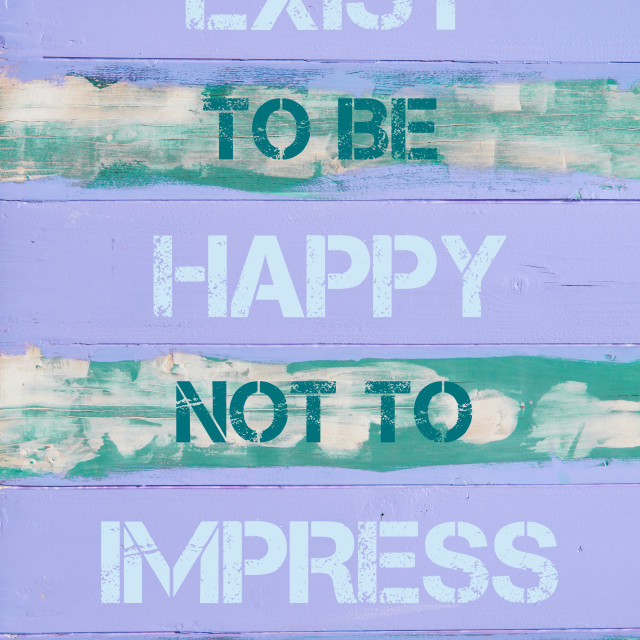 """""""EXIST TO BE HAPPY NOT TO IMPRESS"""" stock image"""