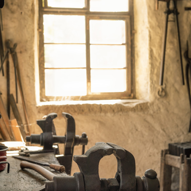 """""""Blacksmith workbench with a vise grip"""" stock image"""