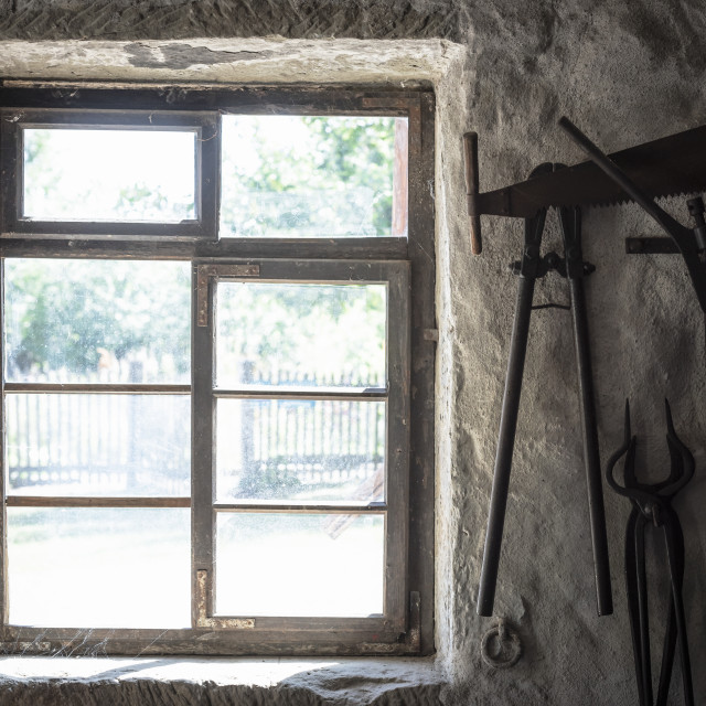 """Old rustic window and blacksmith tools"" stock image"