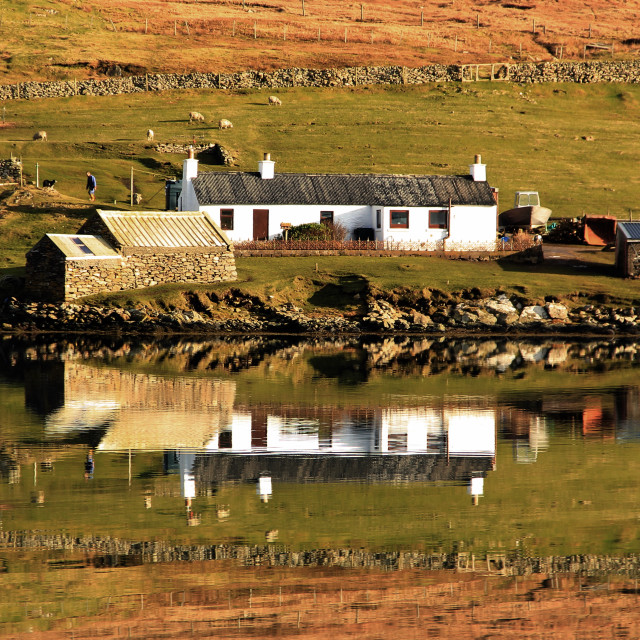"""Reflections of a Cottage"" stock image"