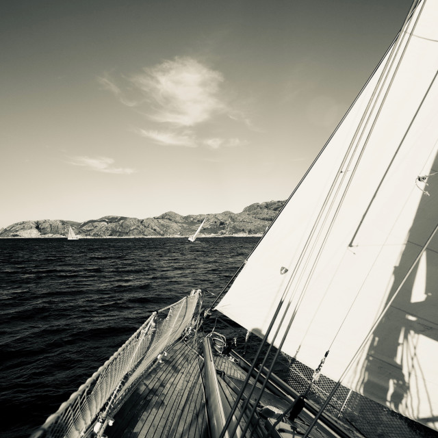 """Sailboat with wind in sails"" stock image"