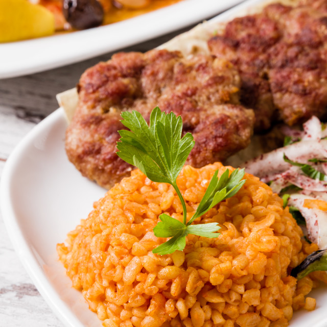 """Bulgur Pilaf Served with Meatball in White Plate"" stock image"