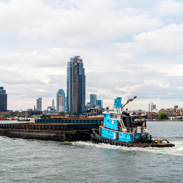 """Tugboat pushing barge in New York City"" stock image"