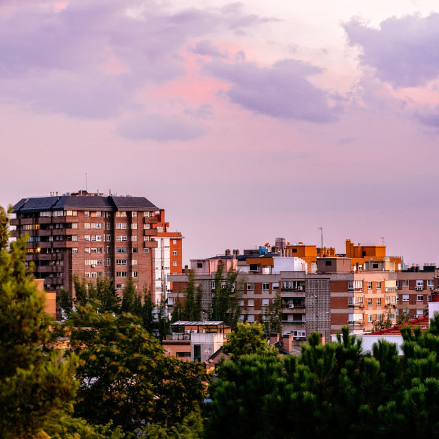 """Cityscape of residential area of Madrid at sunset"" stock image"
