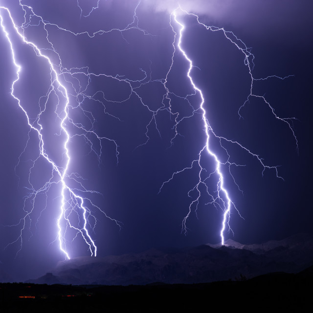 """Lightning bolts strike the Superstition mountains."" stock image"