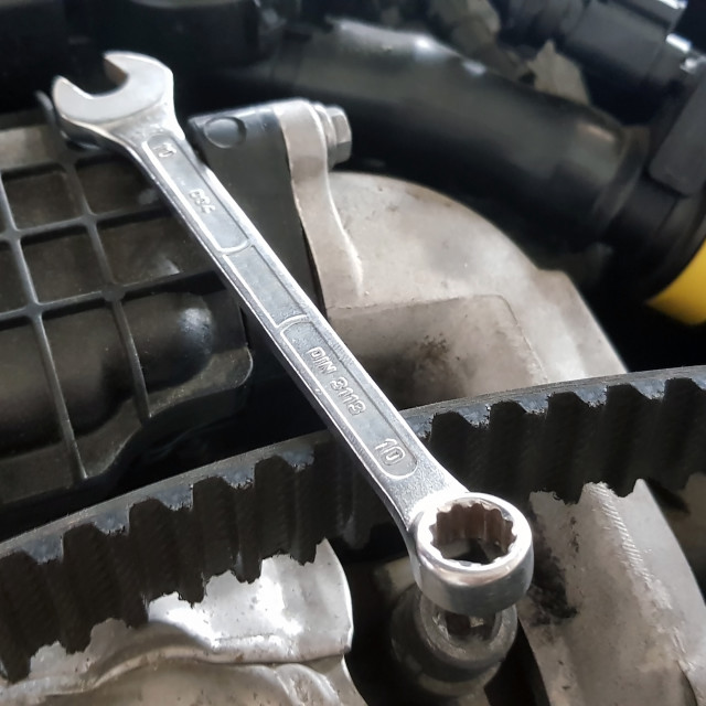 """Spanner and timing belt on car engine"" stock image"
