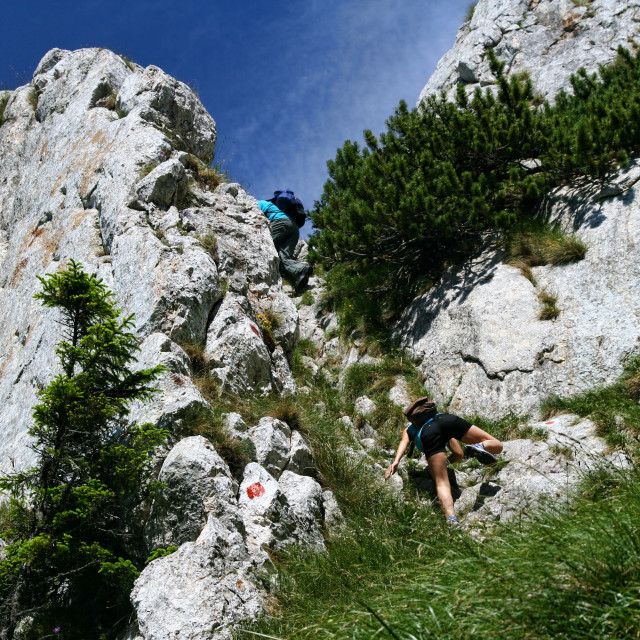 """Teens climbing in Carpathians"" stock image"