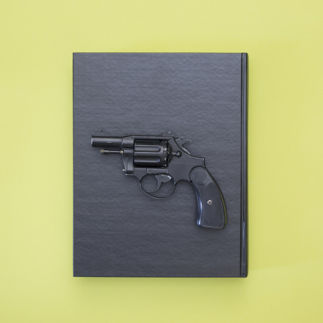 """""""Revolver and black book on a colored background"""" stock image"""