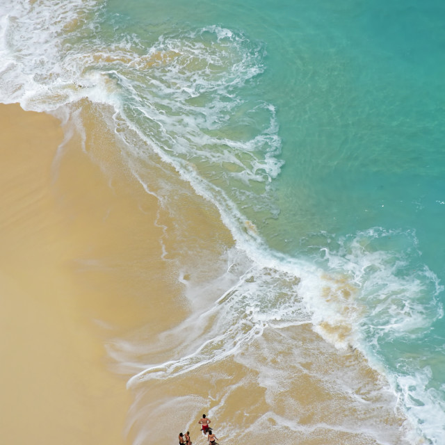 """""""Aerial view of ocean waves and people"""" stock image"""