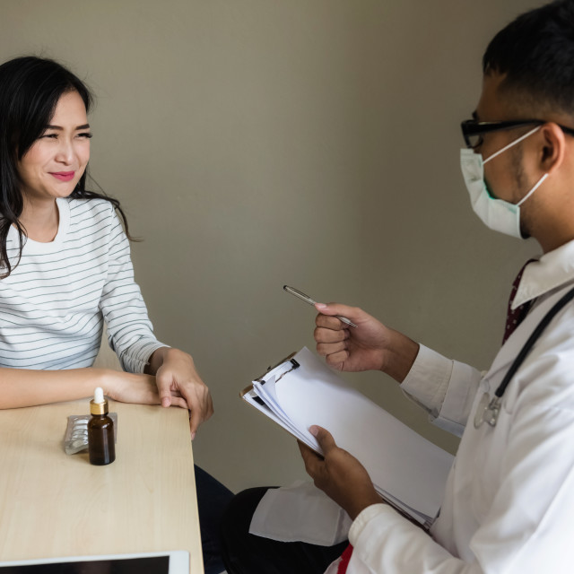 """Asian doctor diagnose patiient woman in hospital"" stock image"