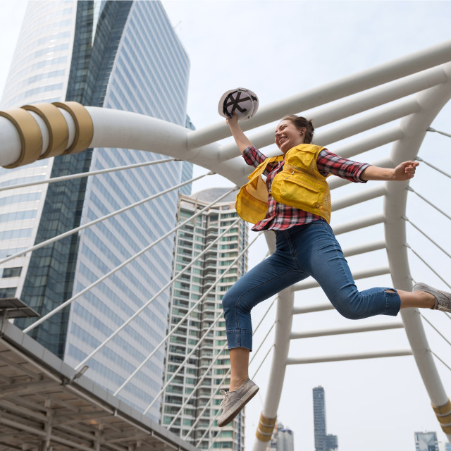 """Happy American engineer jump in city"" stock image"