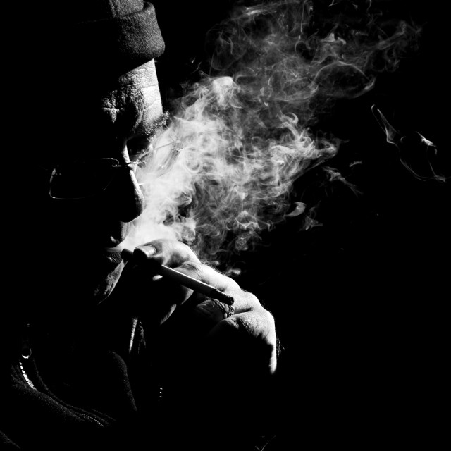 """Elderly man is smoking cigarette"" stock image"