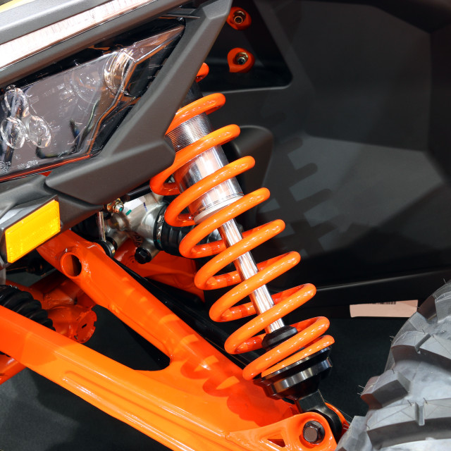 """all terrain vehicle shock absorber detail"" stock image"