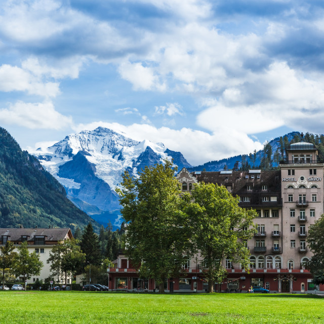 """""""Park in Central Interlaken with mountain peak view of Jungfrau i"""" stock image"""