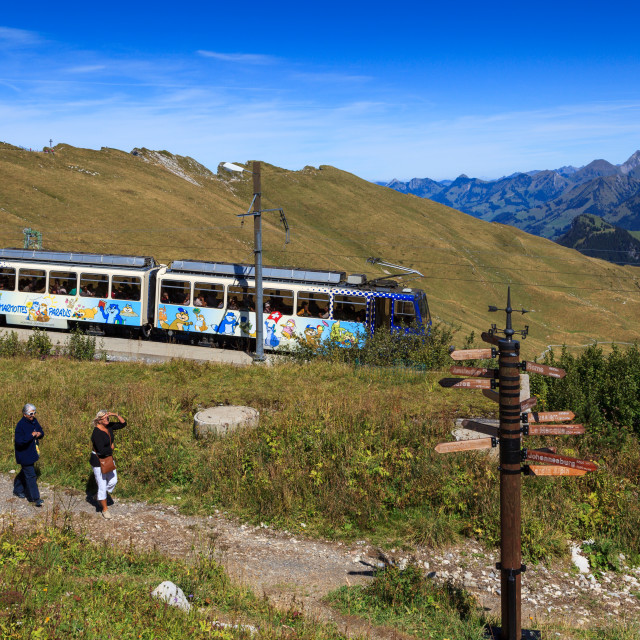 """""""People walking on path by Cog railway train at station of Rocher"""" stock image"""