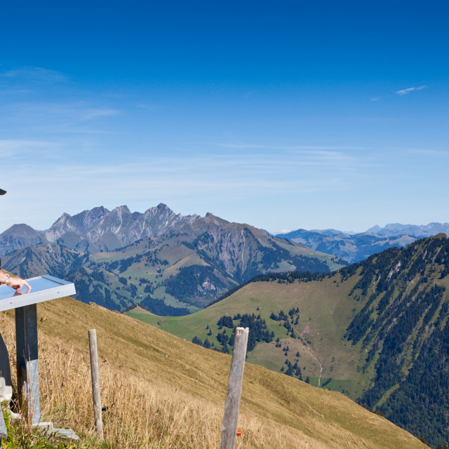 """""""Man checks out the view of the Alps on the mountain of Rochers-d"""" stock image"""