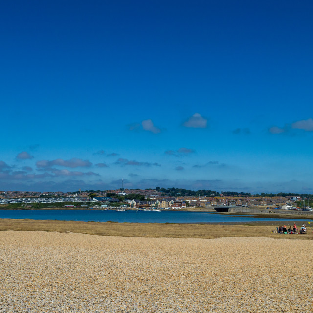 """""""Fleet lagoon from Chesil beach with the village of Wyke Regis in the distance, Dorset, England, UK. Fleet lagoon lies between Chesil Beach, and the mainland Dorset shore, just west of Weymouth and the Isle of Portland. It is thought to be one of the large"""" stock image"""