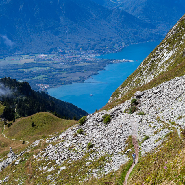 """""""Man walking along the vast hillside of Rochers-de-Naye near Mont"""" stock image"""