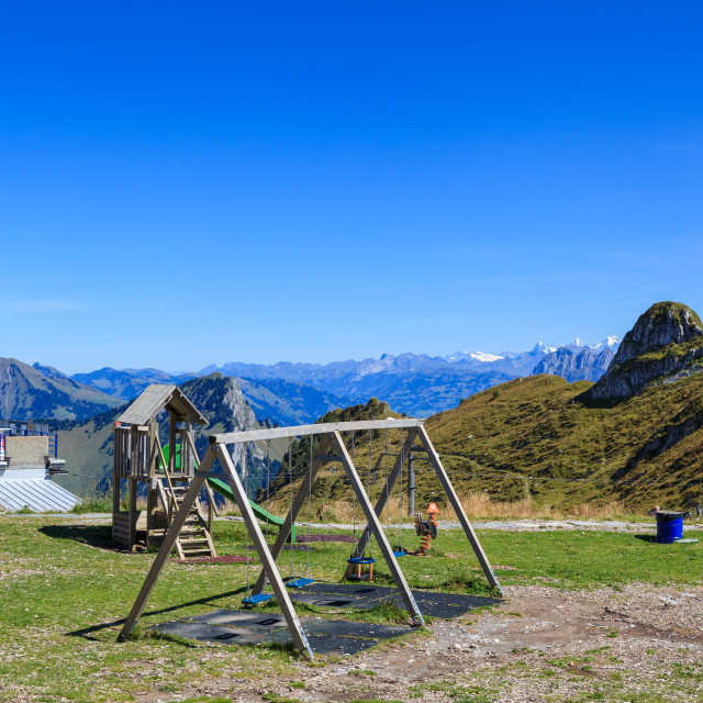 """""""Childrens playarea and terrace on summit of mountain of Rochers-"""" stock image"""
