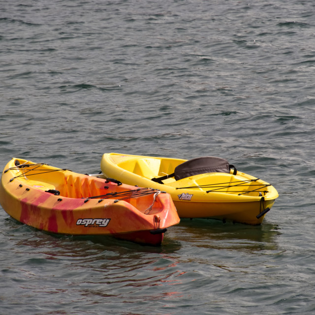 """Fibreglass sit-on canoes"" stock image"