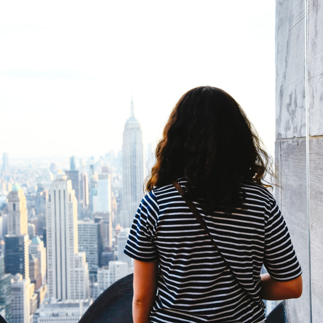 """A Woman looking at New York skyline"" stock image"