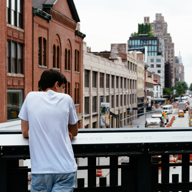 """Young man looking at New York cityscape"" stock image"