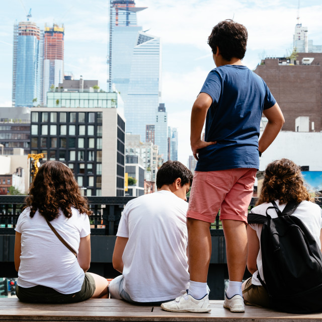 """Young people sitting on High Line in New York"" stock image"