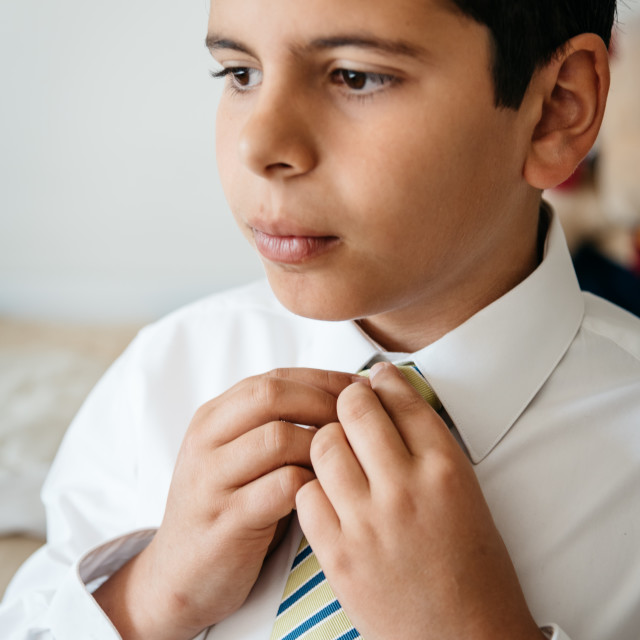 """A Young boy getting ready for celebration"" stock image"