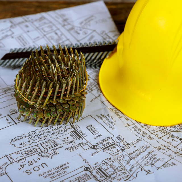 """""""Nails for pneumatic nail gun and helmet for construction a plan of the new house"""" stock image"""