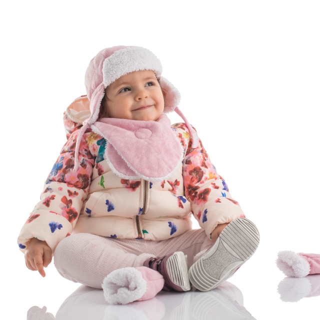 """Portrait of happy little baby girl wearing pink winter hat and f"" stock image"