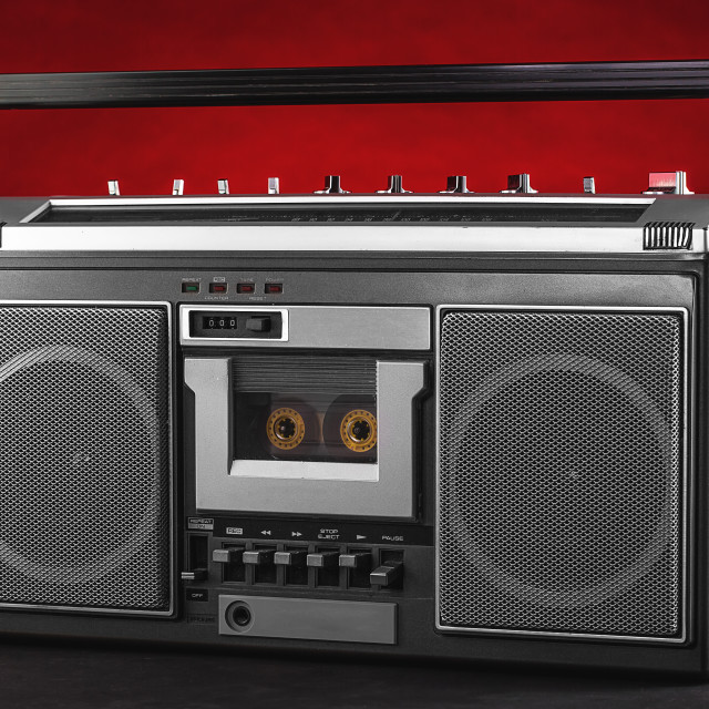 """1980s Silver retro radio boom box on red background"" stock image"