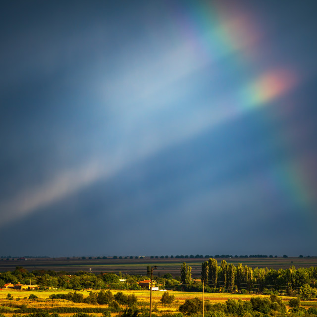 """Rainbow and sky background"" stock image"